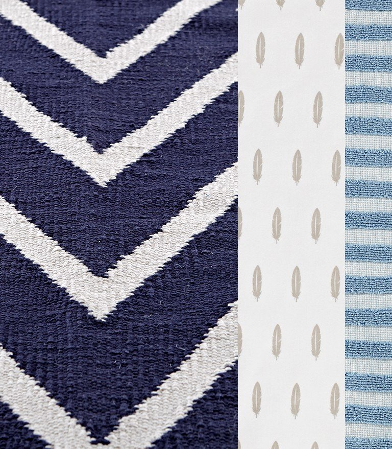 Fabric with a feather pattern, chevron pattern and stripes.