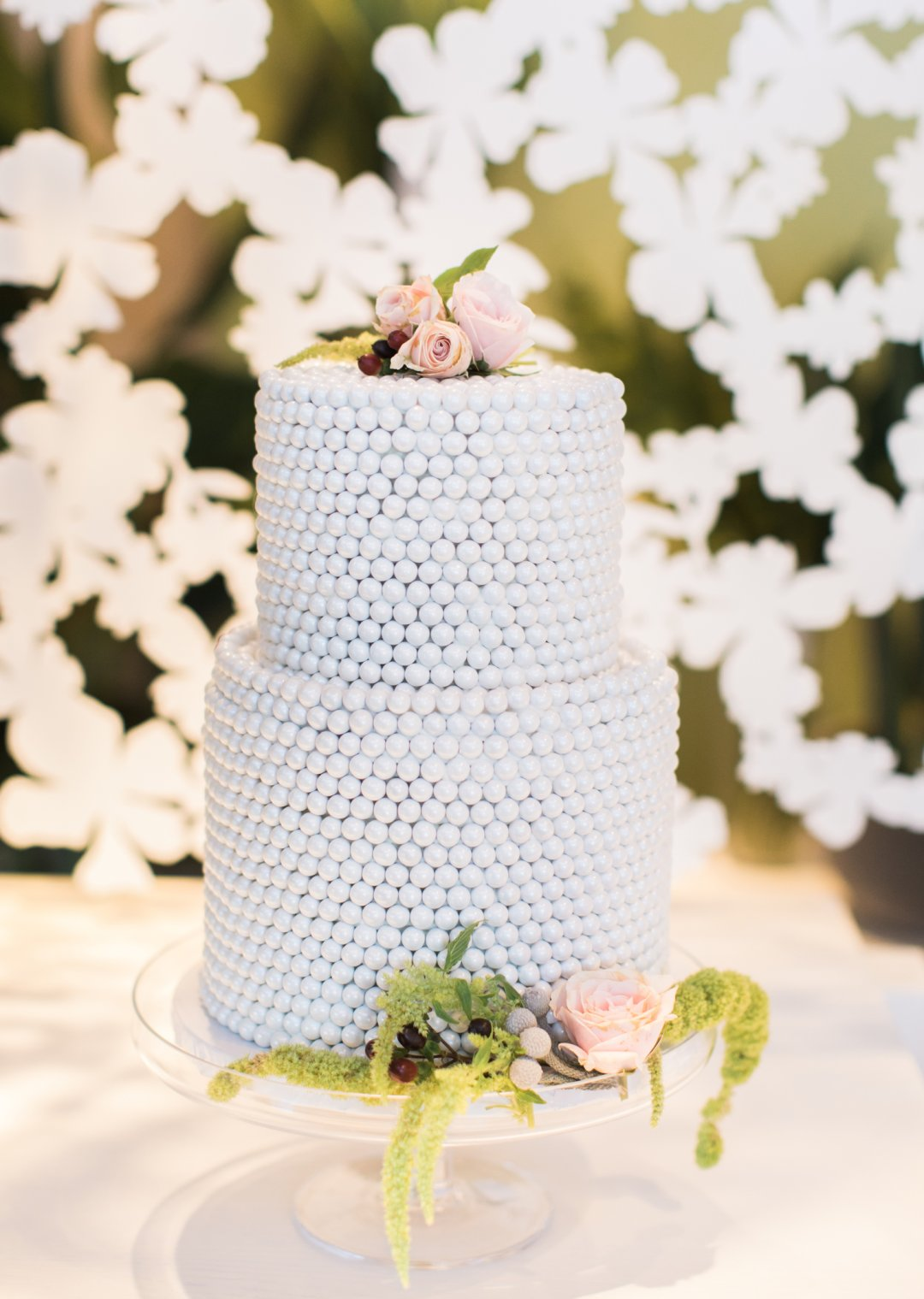 White beaded wedding cake on display