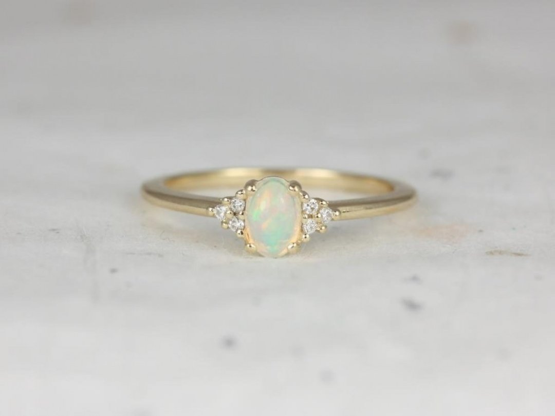 A picture of a gold opal ring