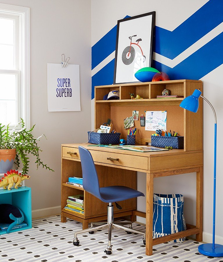 A boys bedroom has a bold blue painted stripe