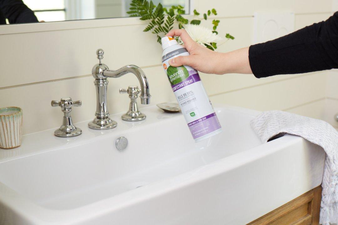 disinfectant spray being sprayed on bathroom vanity