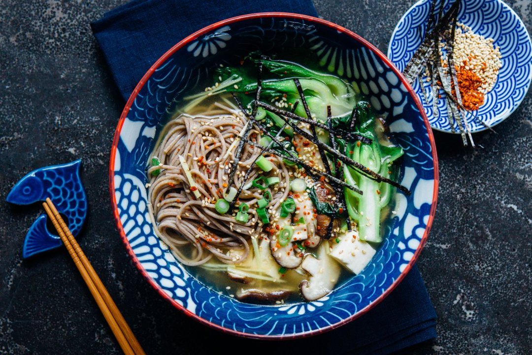 Vegan miso soba noodle soup in a blue bowl