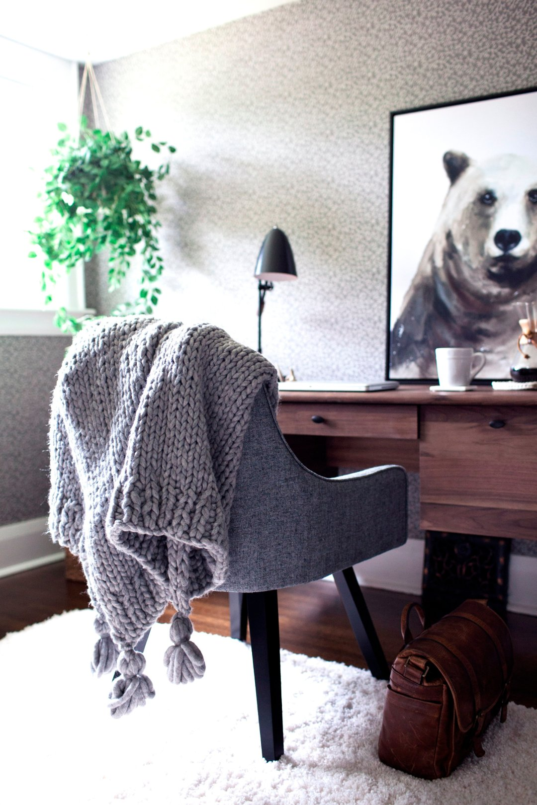 Desk with chair and blanket draped over it