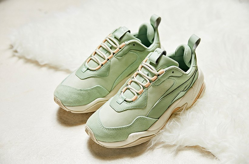 The bulkiness of the sneak is contrasted with the soft muted tones of  Natural Vachetta Cream Tan and Smoke Green Silver Green 5c54937c7