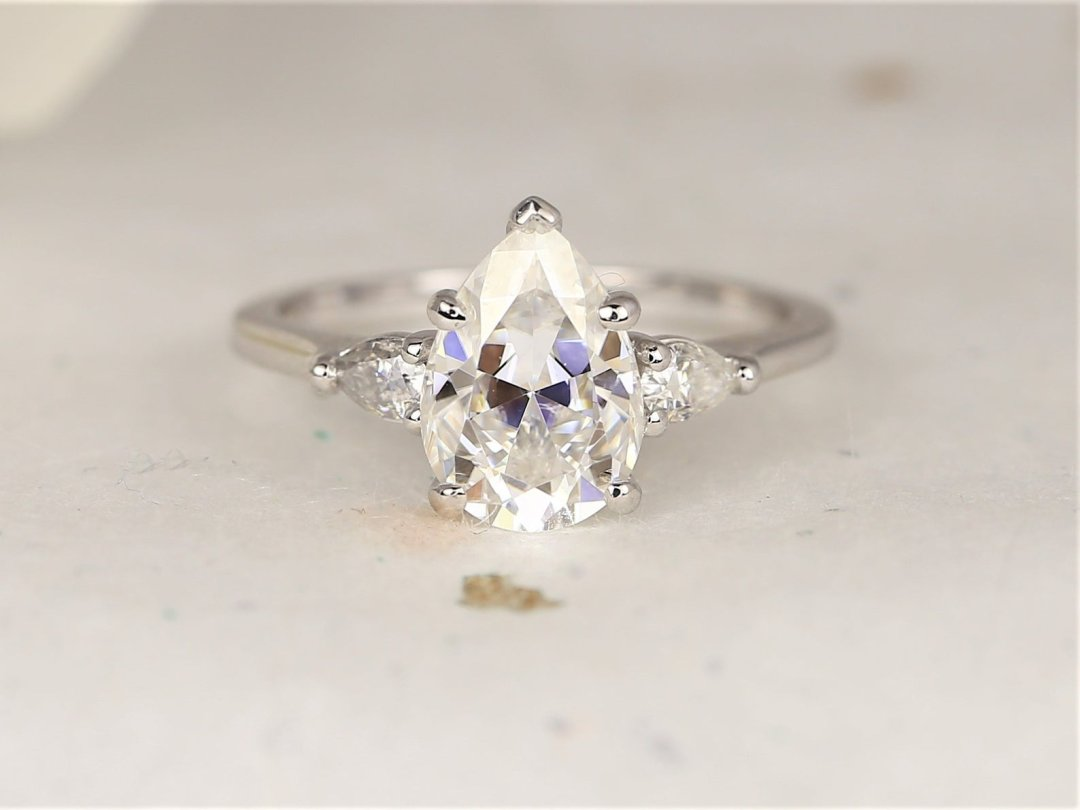 close up of pear shaped stone engagement ring with white gold band