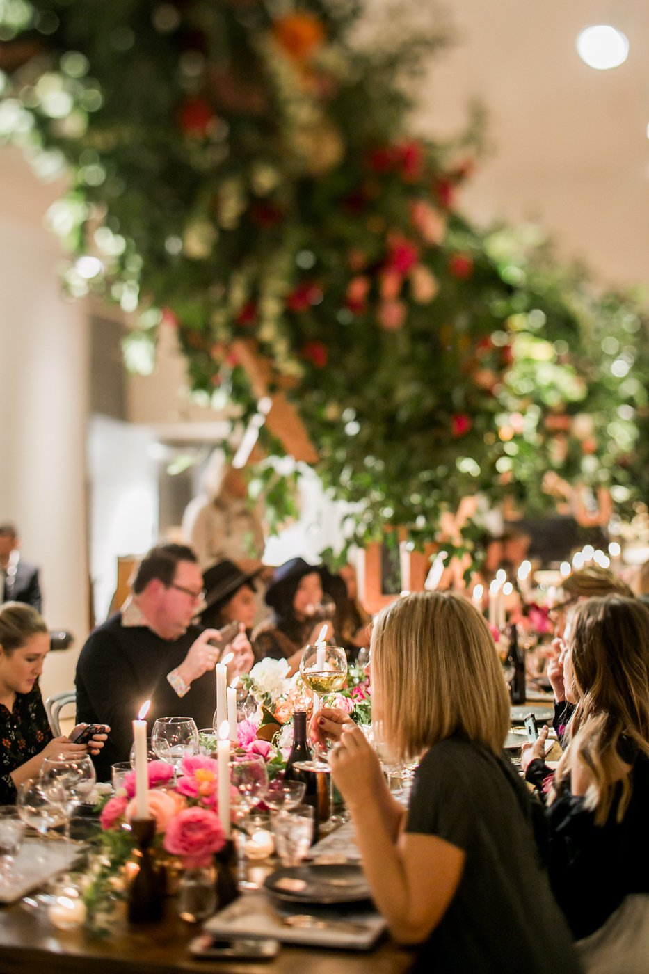 Guests sit at Valentine's Day dinner table