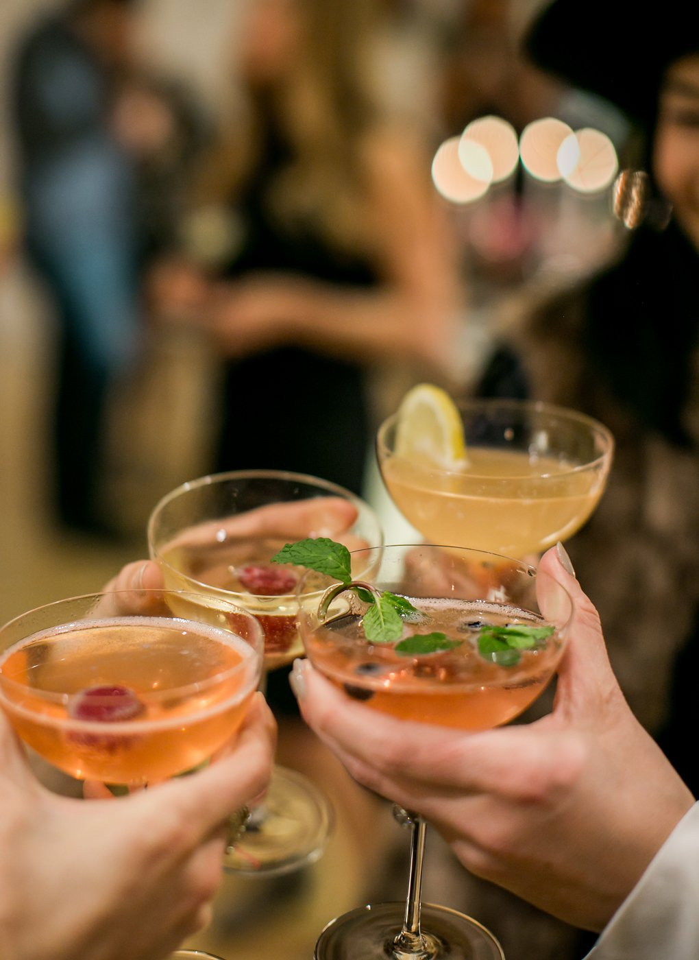 Guests toasting with champagne coupe glass