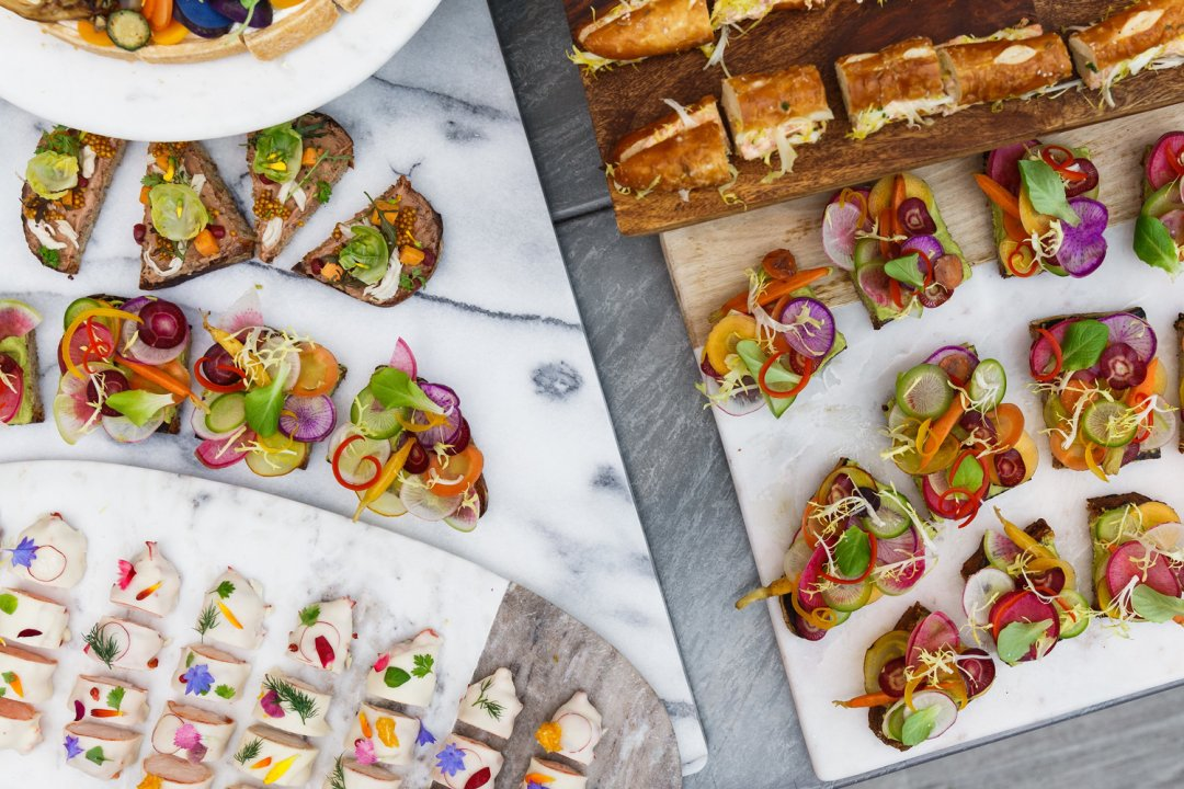 Colorful appetizers displayed on marble boards