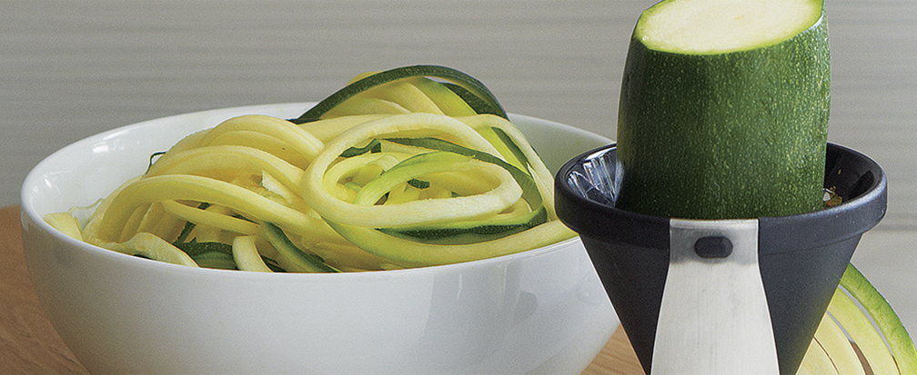 Spiralized zucchini in a white bowl