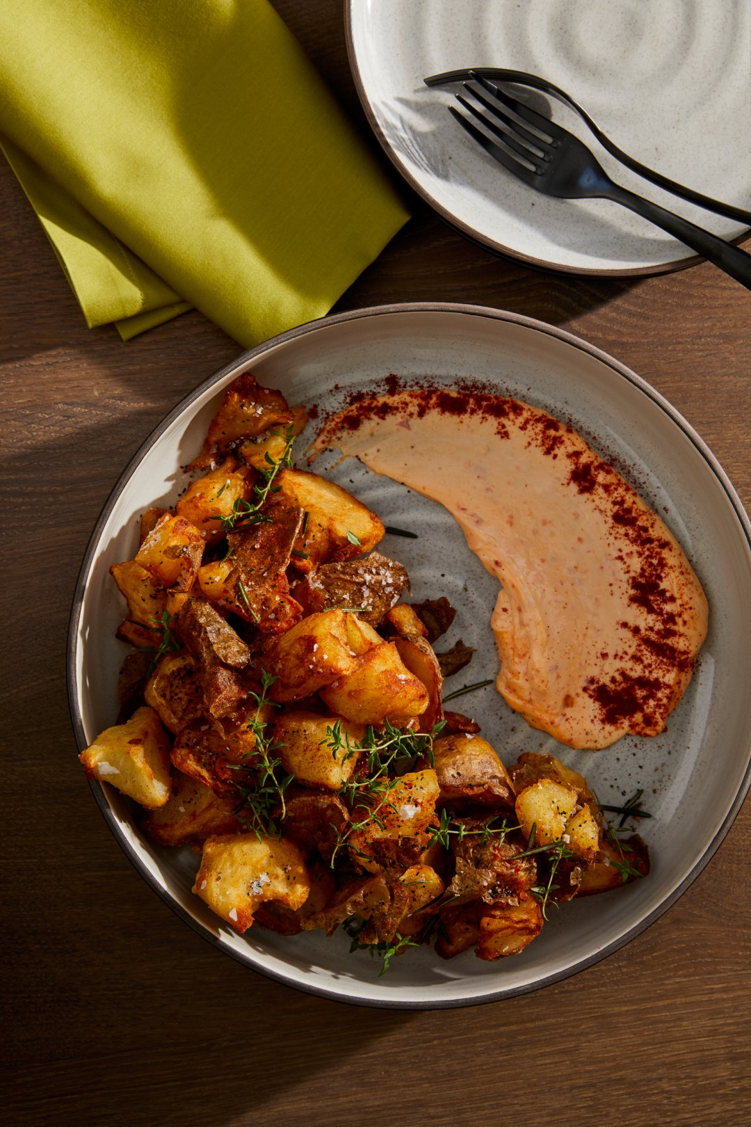Patatas Bravas with a side of Piquillo Pepper Aioli in 18th Street dinnerware