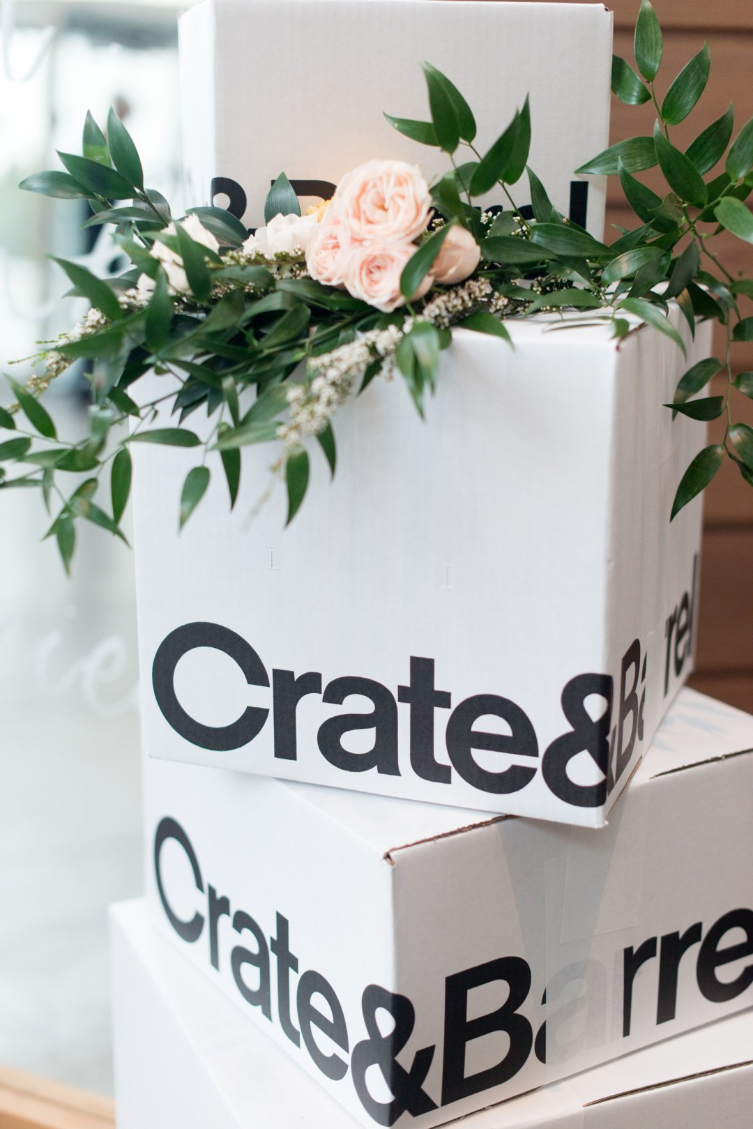 Stack of Crate and Barrel boxes with flowers