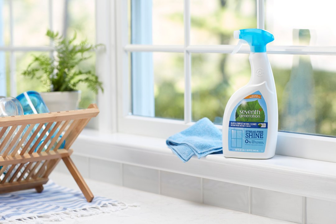 glass cleaner on kitchen window sill