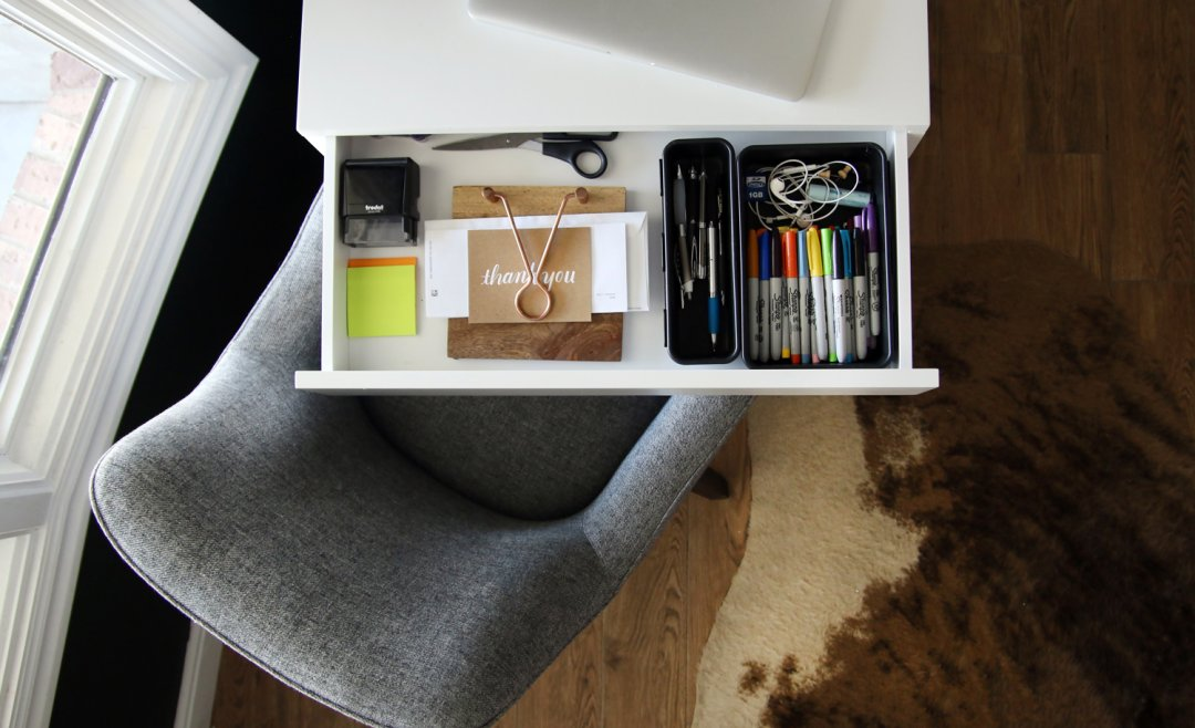 Drawer organizers holding pens, markers and papers in desk drawer