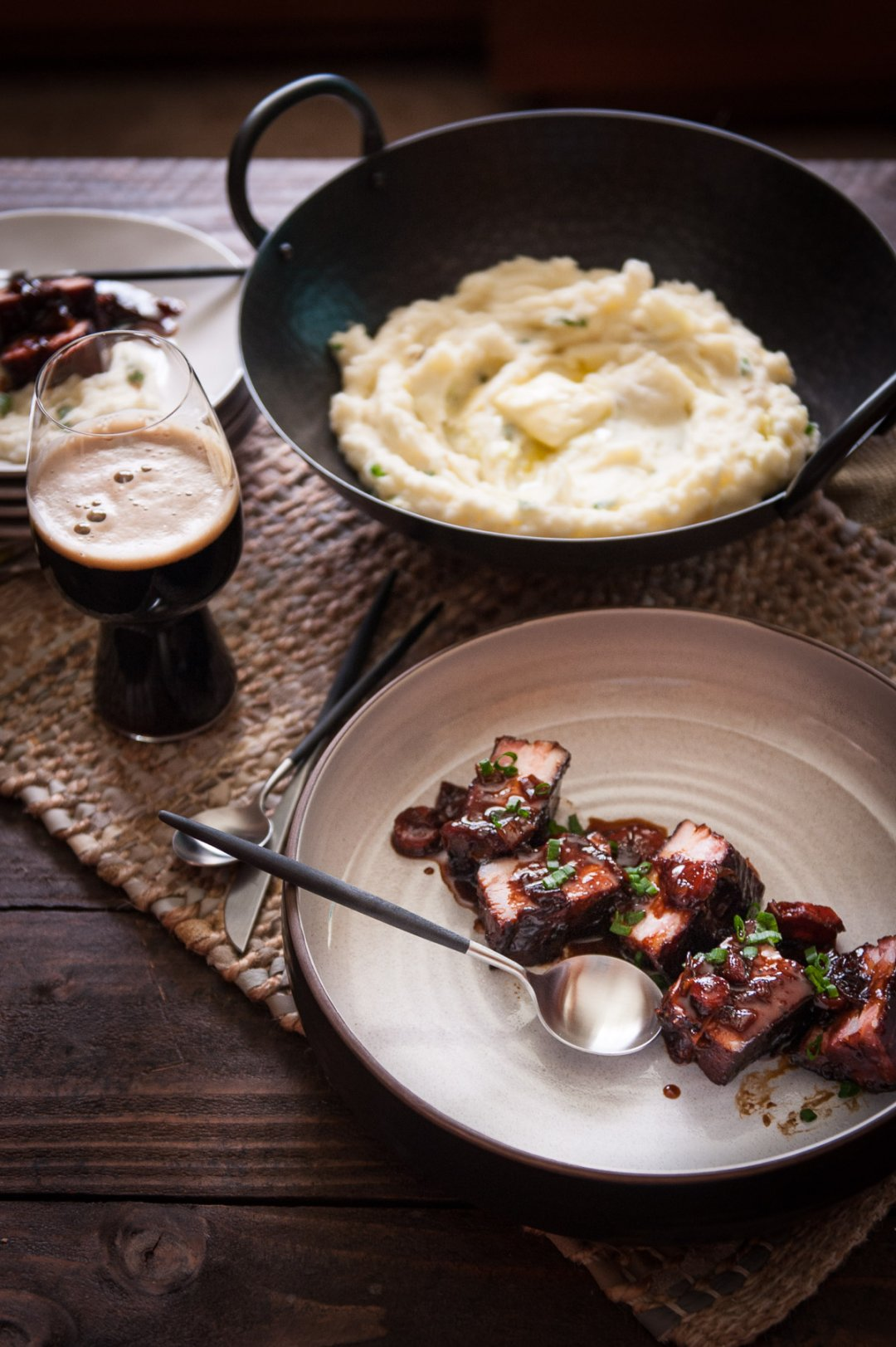 Dish of beer braised Irish bacon slab and colcannon potatoes