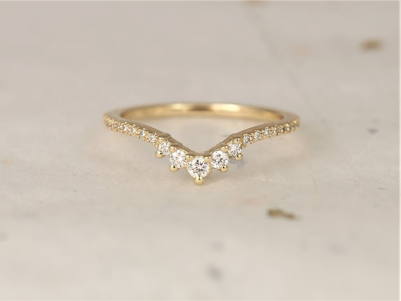 solid gold stacking ring with chevron curve lined with diamonds