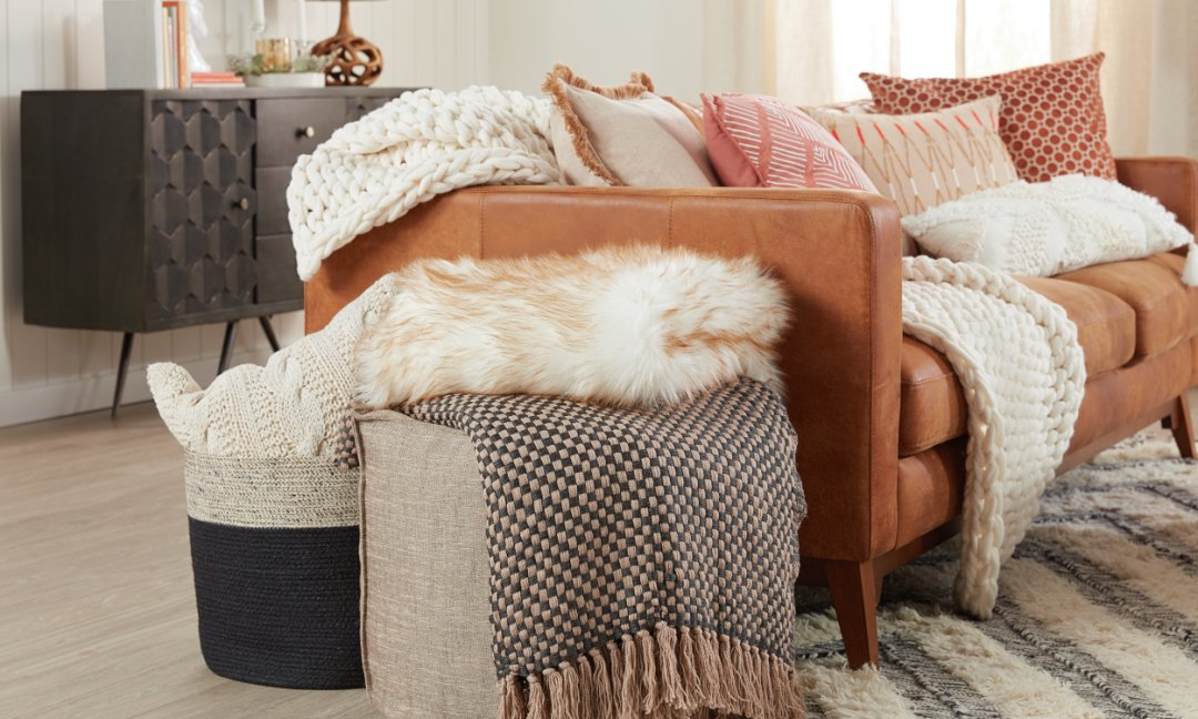 Cozy Hygge Home- Textured throw pillows styled on a couch