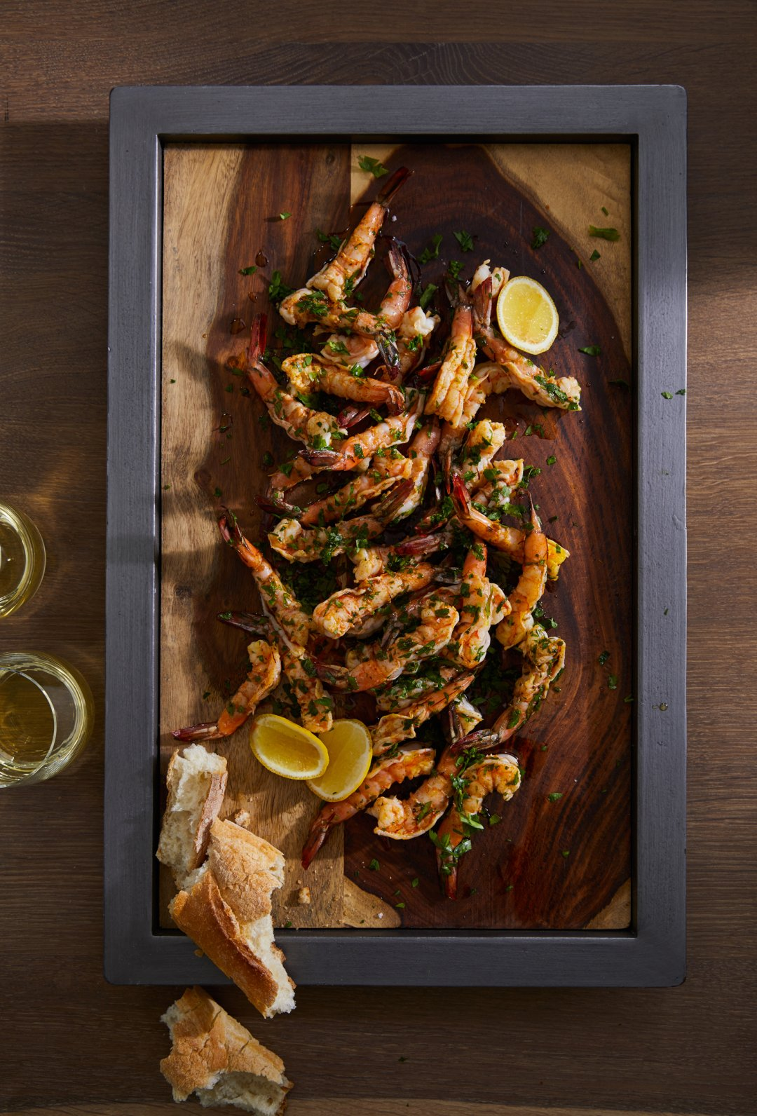 Saffron Poached Prawns on wood and metal serving tray