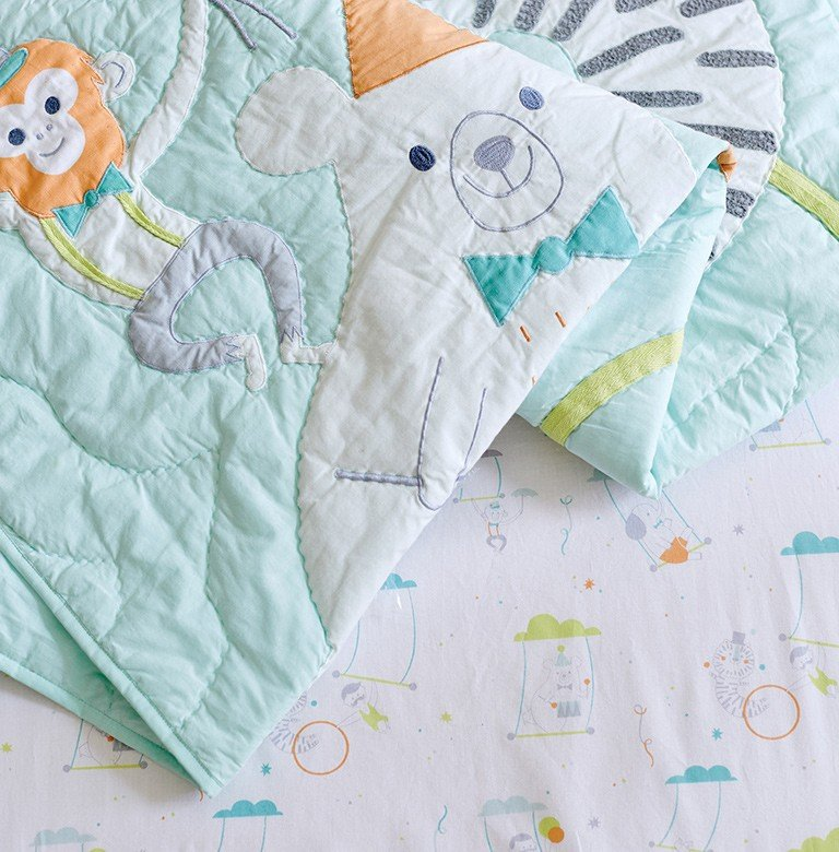 Adorable circus themed baby quilt and crib sheet.