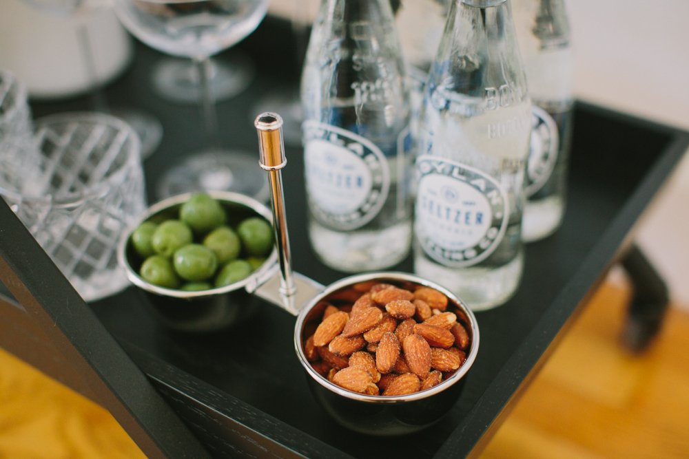 Roasted almonds in a silver snack bowl on barcart