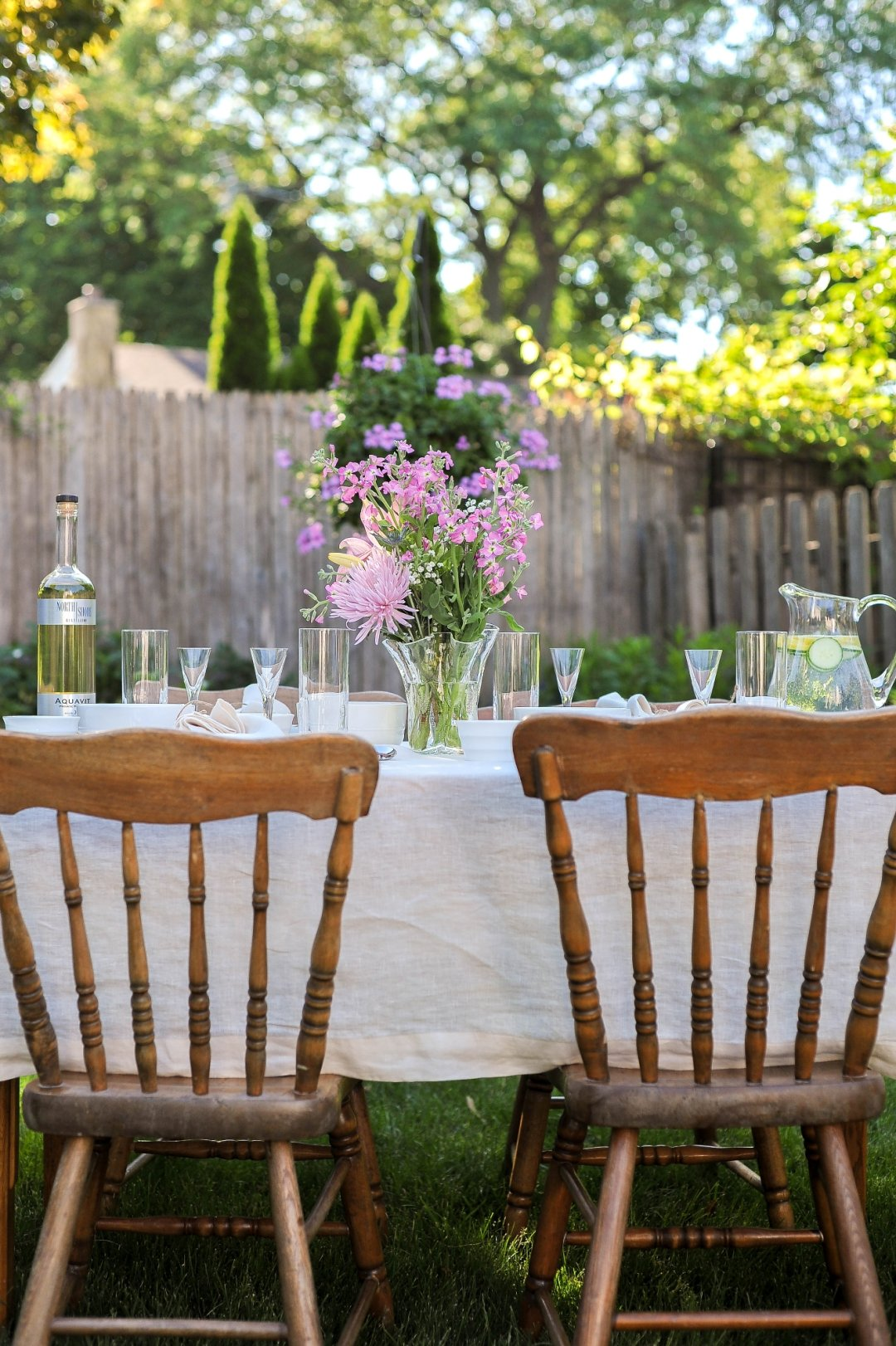Two chairs at outdoor table set for party