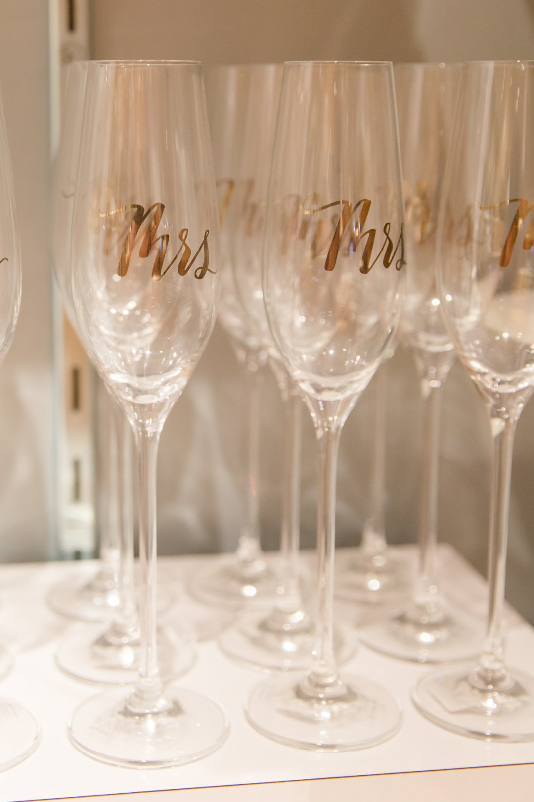 Mrs. in gold lettering on champagne glasses