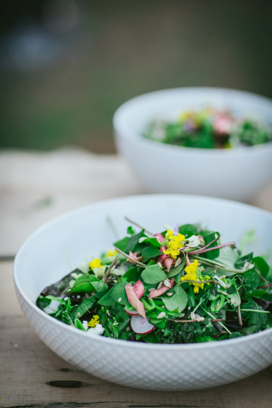 White bowls filled with green salads