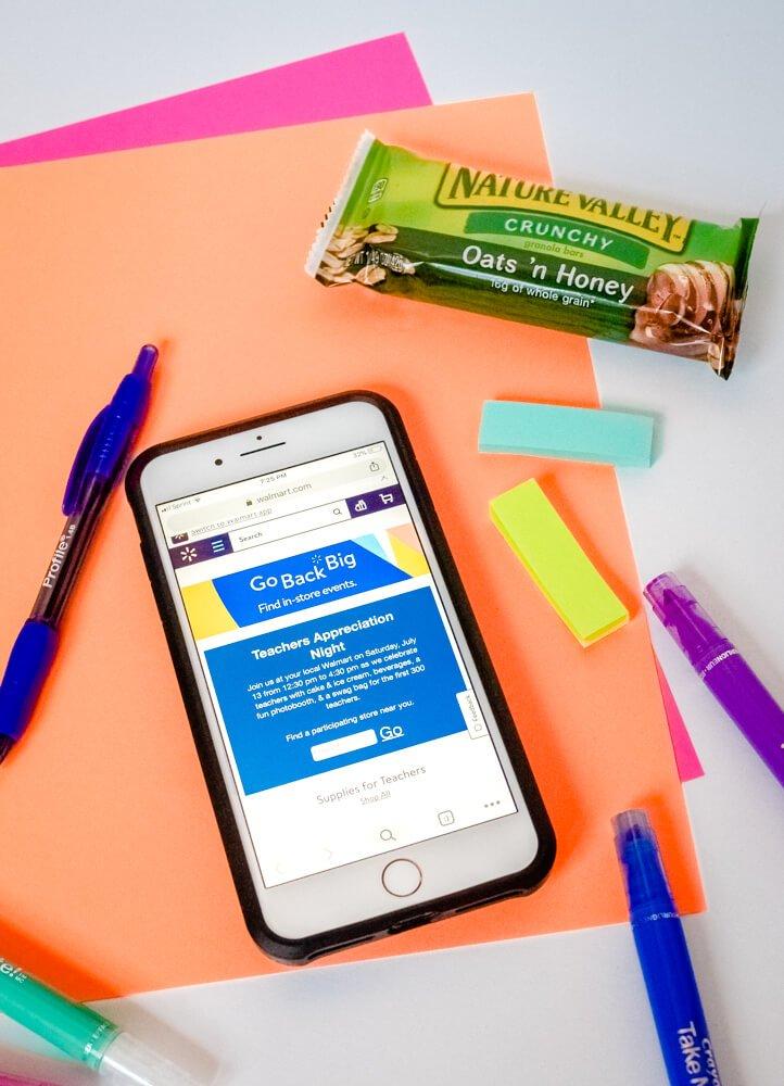 Mobile phone displays web announcement for Walmart teacher appreciation event.