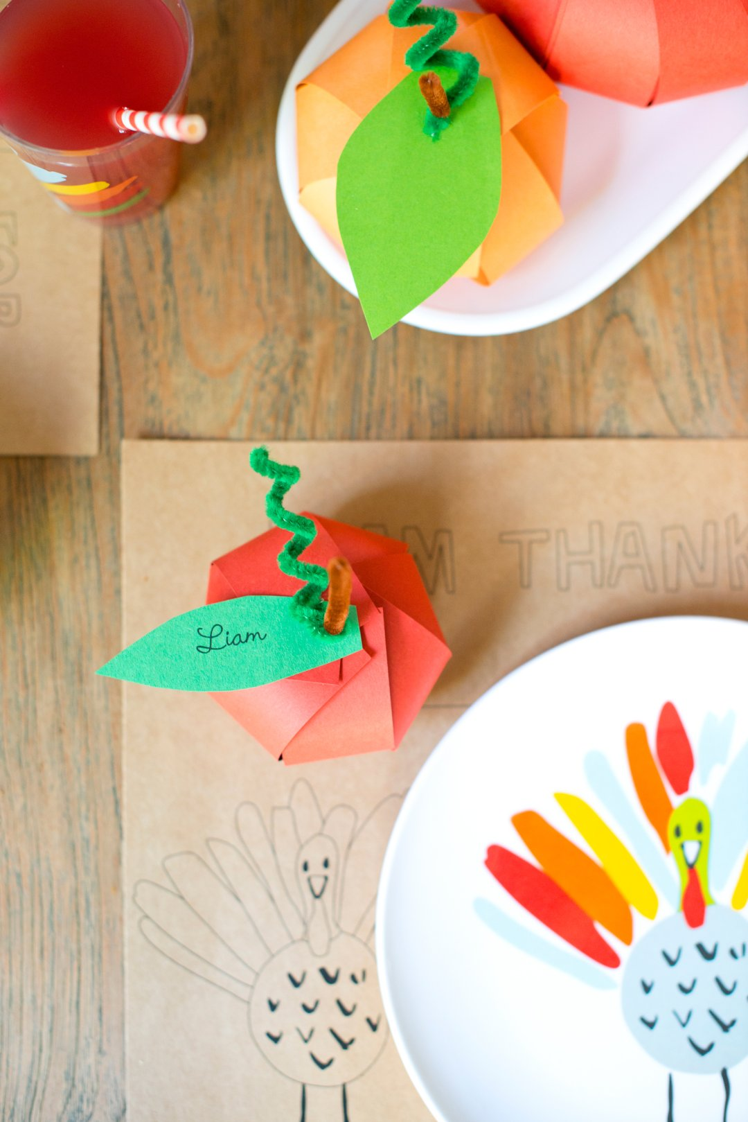 Homemade kids table placecards made from construction paper and felt pipecleaners