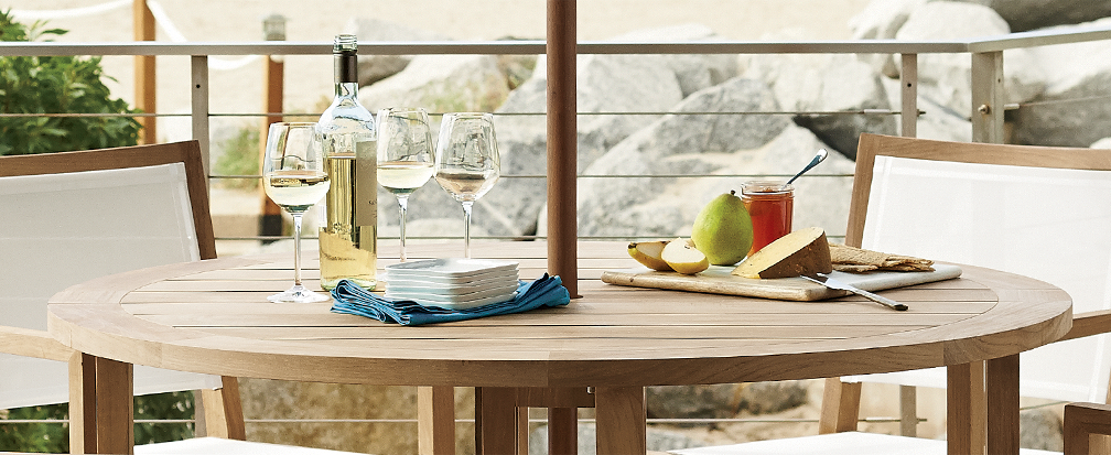 Wooden outdoor entertaining table with wine and cheese