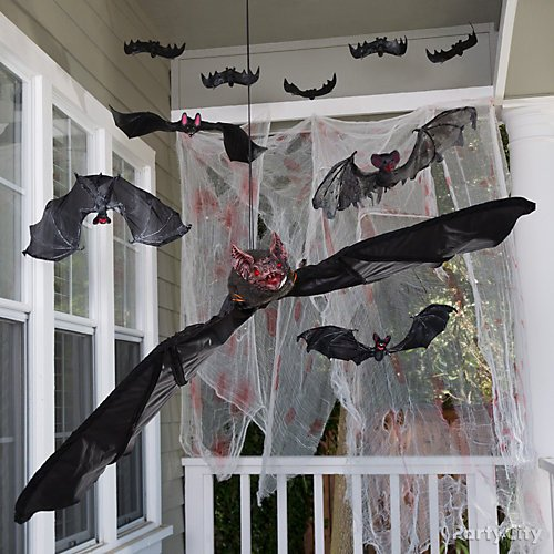 Halloween Porch Decorating Ideas With Haunting Curb Appeal | Party on haunted house design plans, cat room design ideas, haunted house kitchen, red room design ideas, haunted house bathroom, football room design ideas, crafts room design ideas, haunted house foyer, pool room design ideas, haunted house maze floor plan, western room design ideas, space room design ideas, basketball room design ideas, haunted house wall coverings, haunted house furniture, haunted house interior design, emergency room design ideas, haunted house restaurants, haunted house bedroom, haunted house basement,