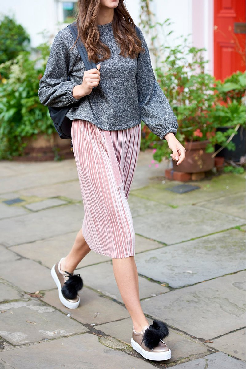 Grey sweater and pink pleated skirt