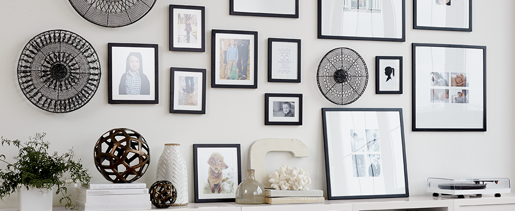 gallery wall with black and white picture frames and decorative metal wall art - Wall Decoration Tips