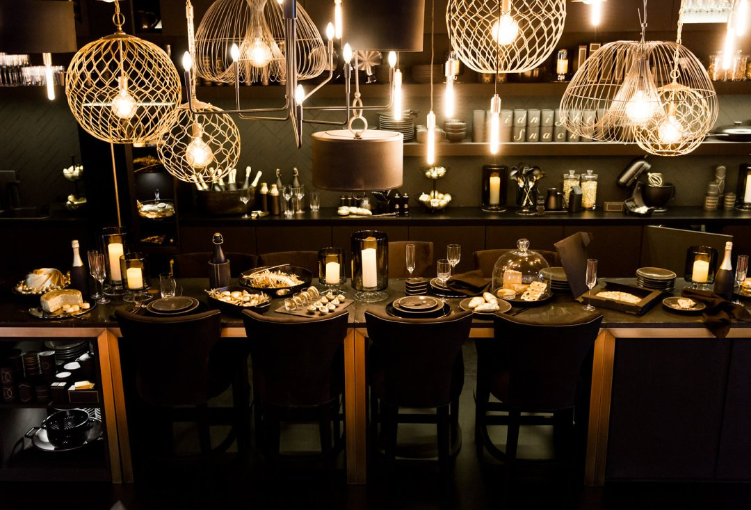 Overall view of table with golden spread and pendant lighting