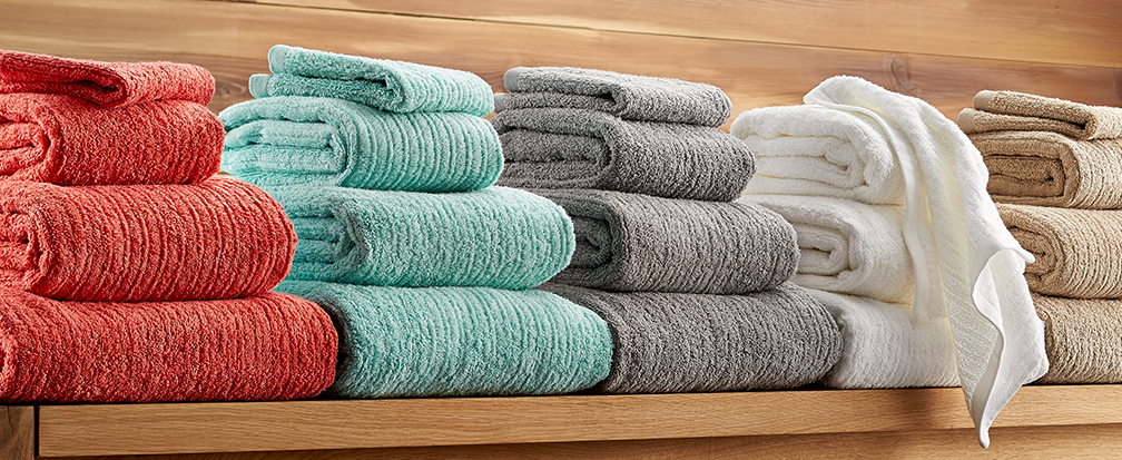Blue, grey, white and tan bath towels