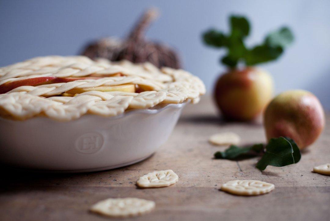 Raw pie crust and decorative crust cut-outs in a pie dish