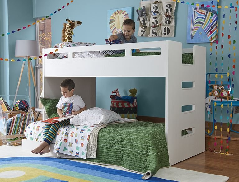 Two boys share a bunk bed in their bedroom.