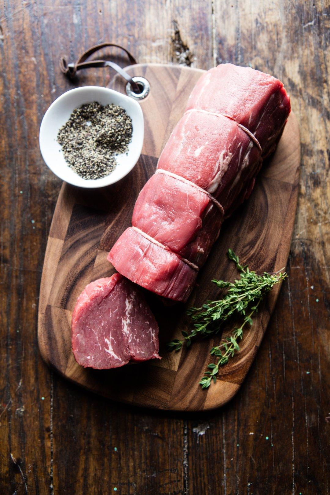 Raw beef filets on cutting board