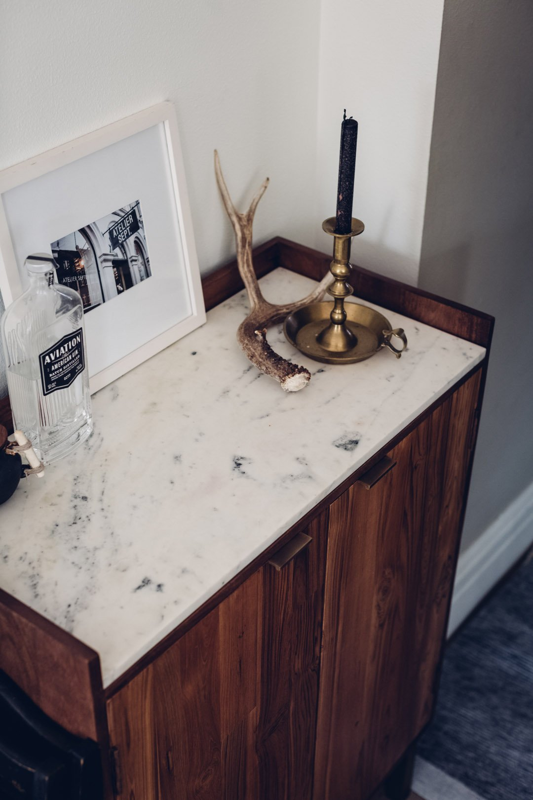 Marble top of bar cabinet with antler decoration