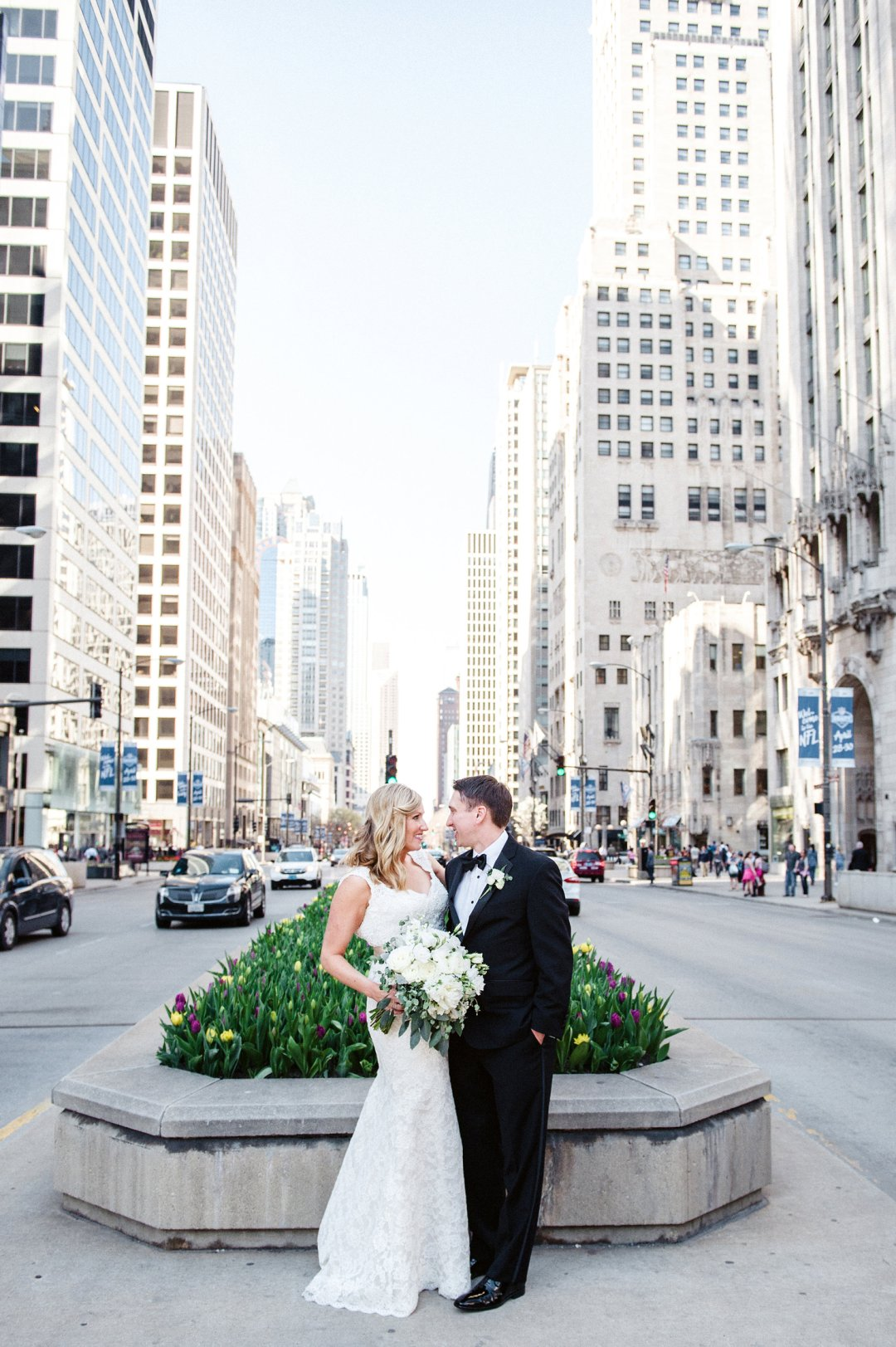 Bride and groom photo together in middle of street