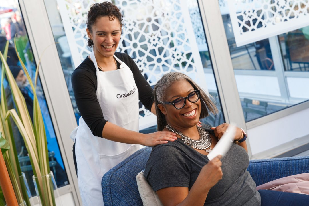 Woman receiving massage at Crate and Barrel spa event