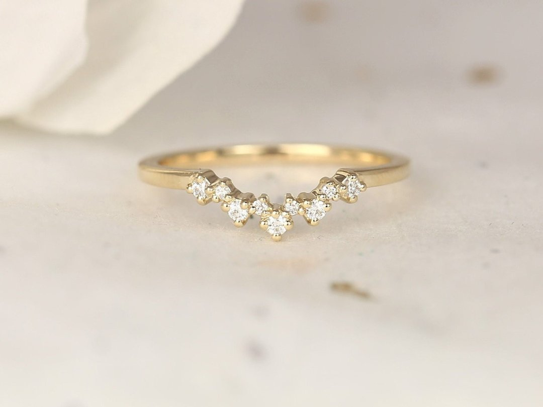 dainty gold stacking ring with scattered diamond clusters