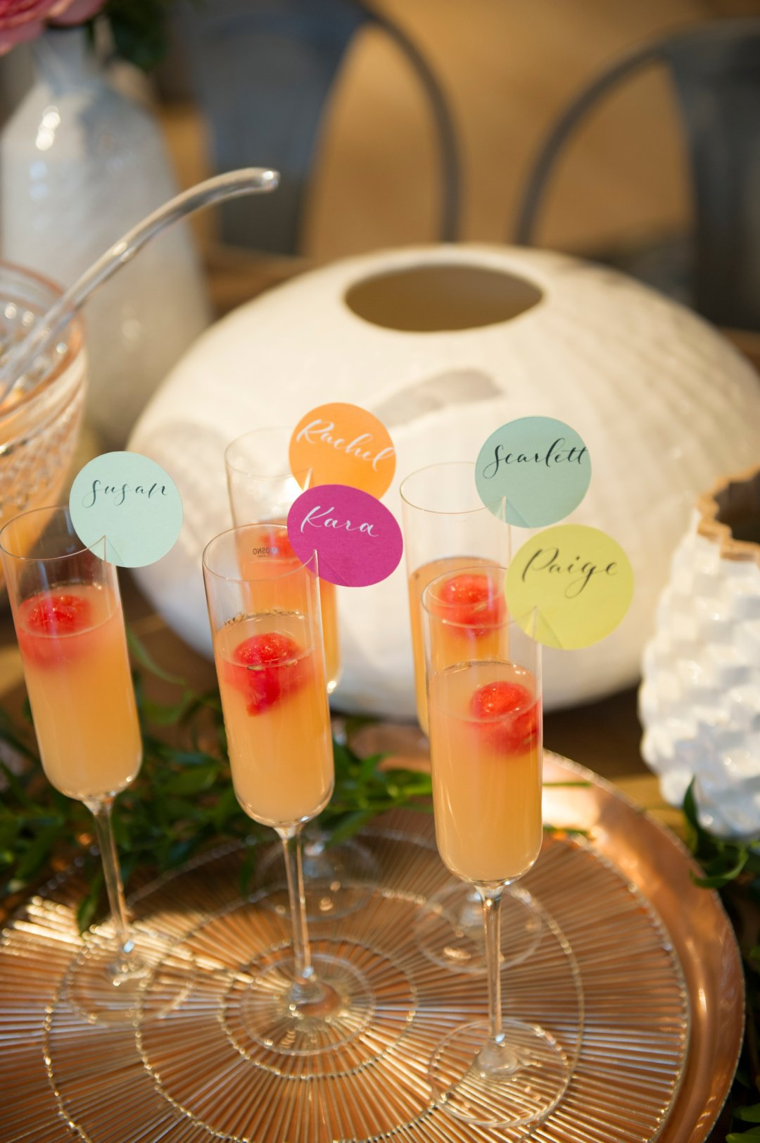 Orange mocktails on tray with name tags