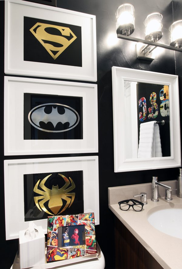 Sophisticated Superhero bathroom with DIY superhero art and black walls