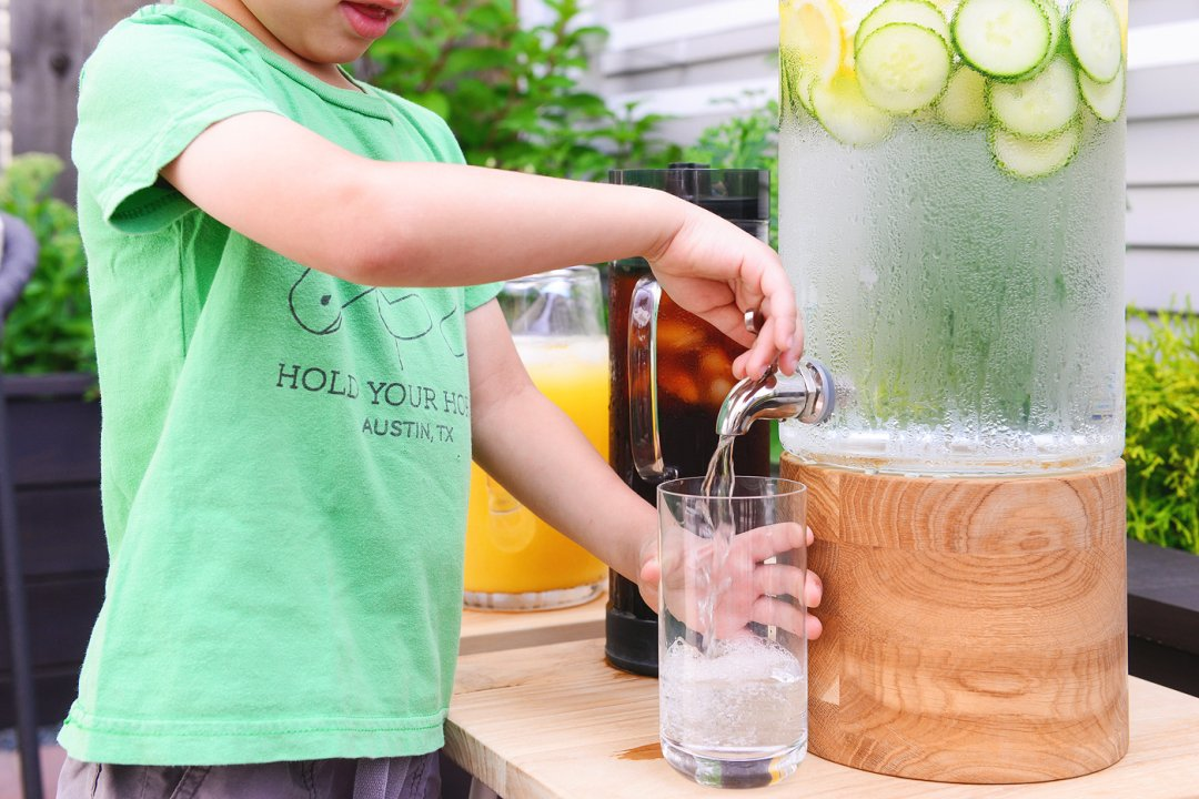 Child dispensing water into glass