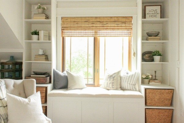 Farmhouse Master Bedroom | farmhouse shelving | builtin shelves | bright and cozy bedroom | master bedroom | farmhouse style | faux beams | faux fireplace | farmhouse bedroom | farmhouse window seat | window seat | master bedroom remodel | master bedroom makeover | white bedroom