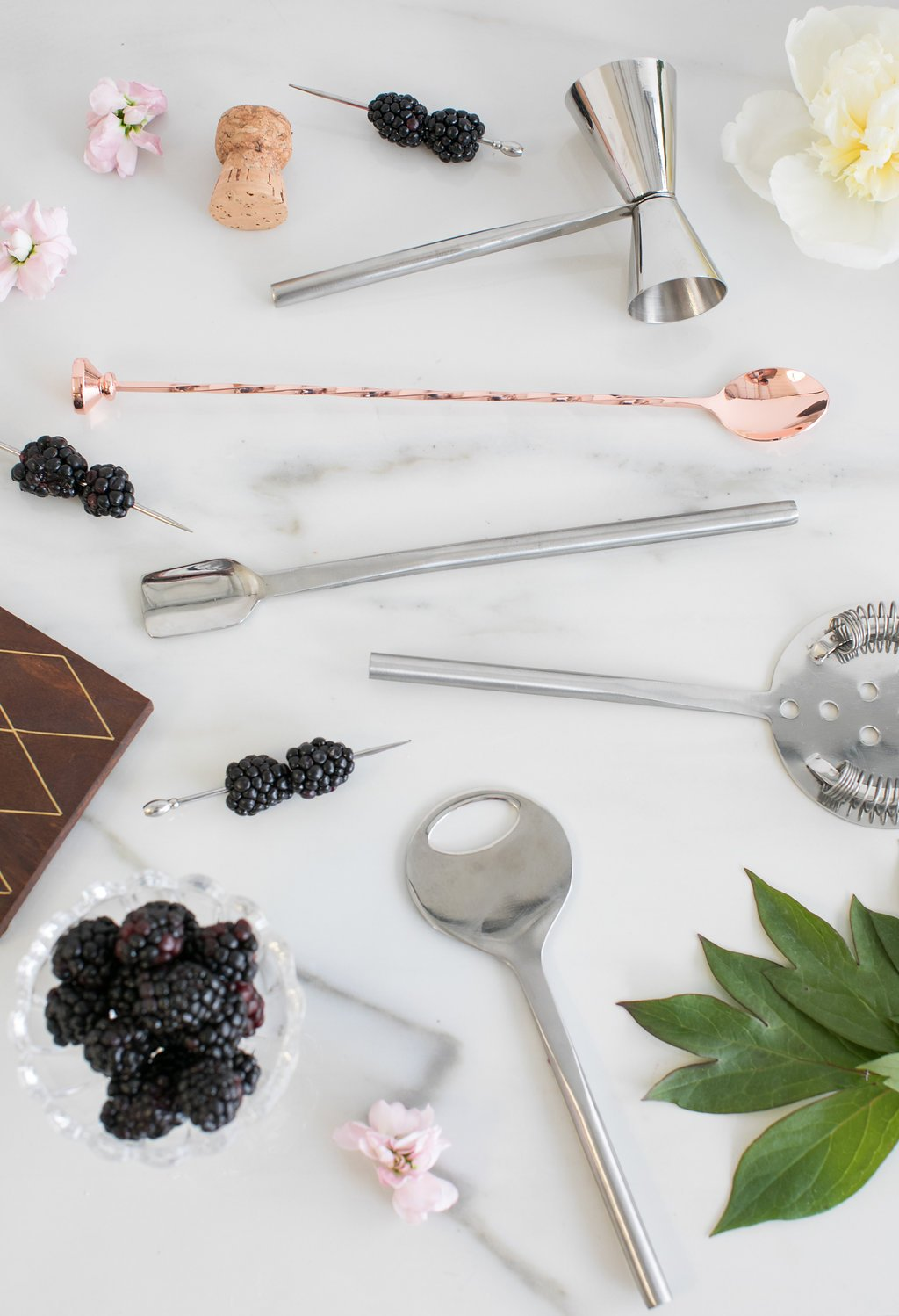 Bar tools laid out on marble slab