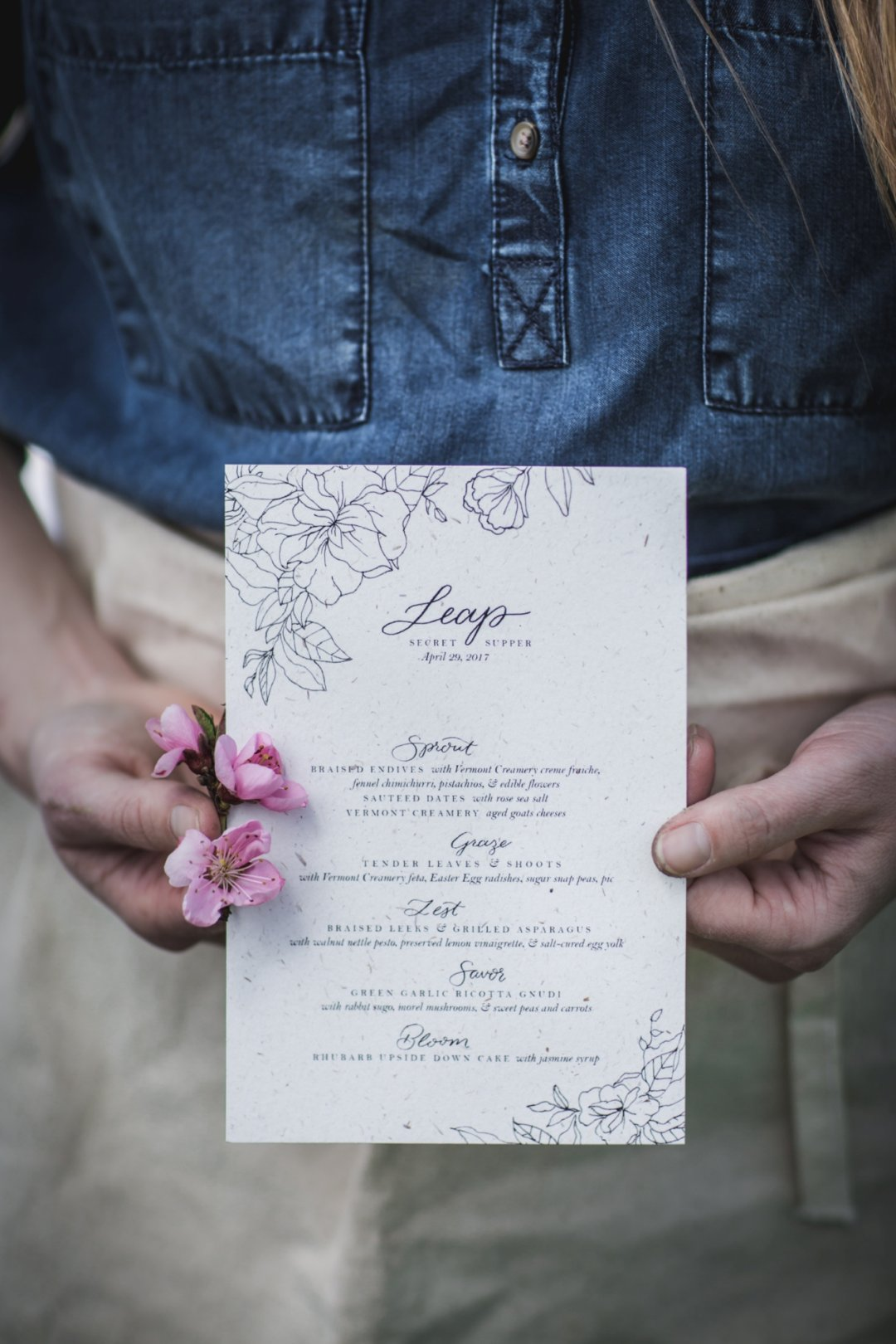 Woman's hands holding supper menu