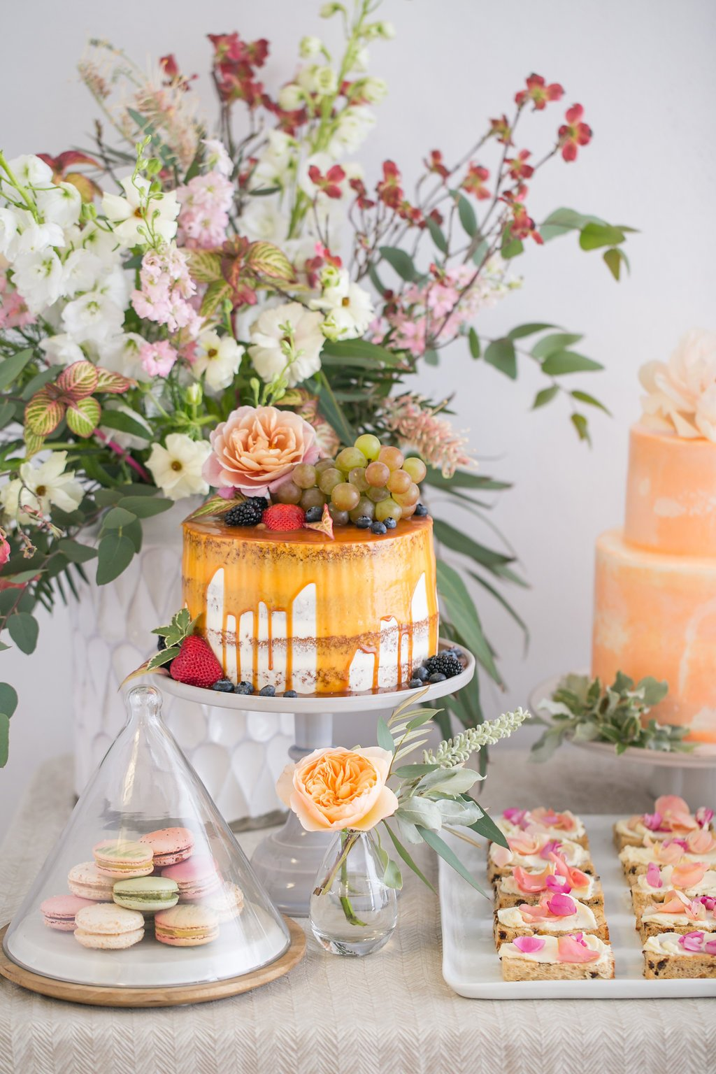 bridal shower dessert table with caramel glaze cake and macaroons