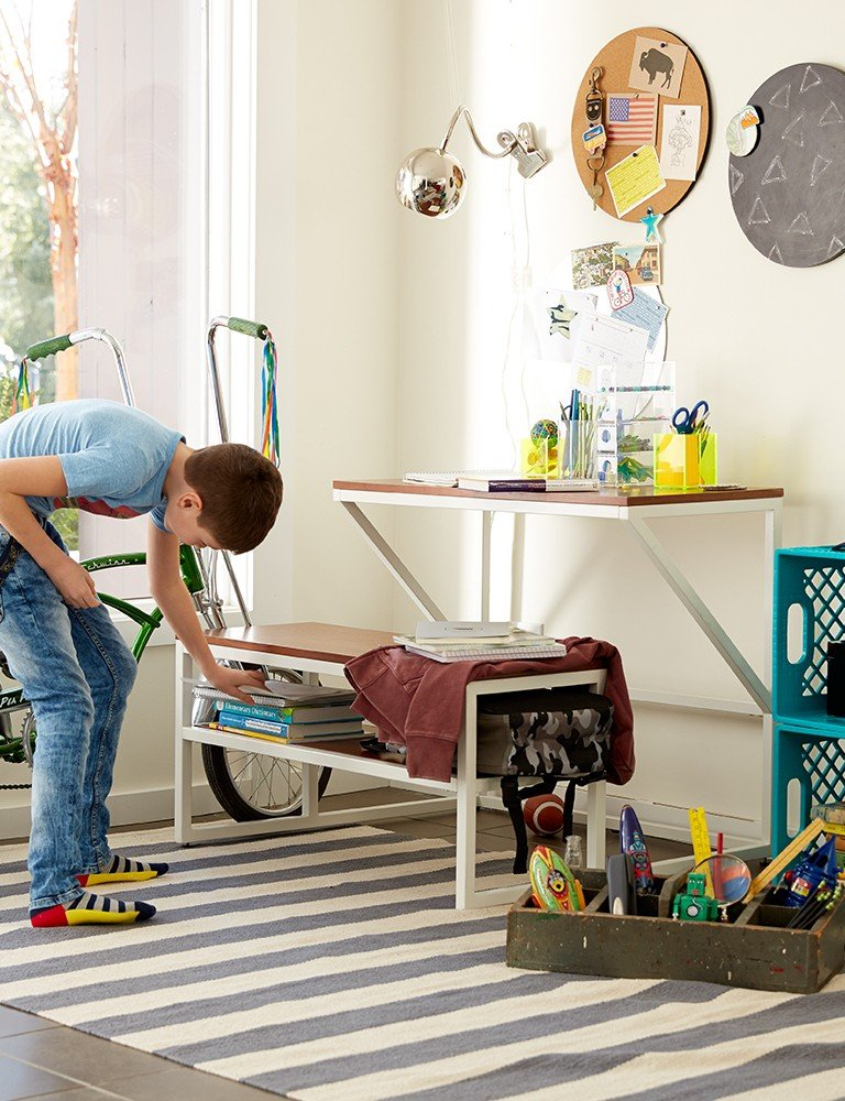 A kids desk offers plenty of storage space for a young boys study room.