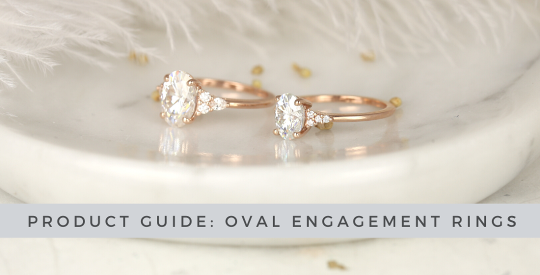 Two Beautiful Oval Engagement Rings on a Granite Countertop